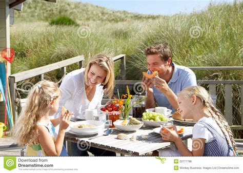 family  vacation eating outdoors royalty  stock