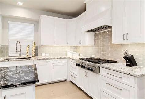 Glass Subway Tile Kitchen Backsplash with White Cabinets