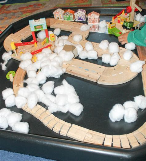 winter small world wooden train play   playroom