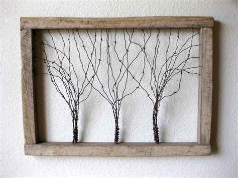 large reclaimed barn wood and barbed wire tree wall