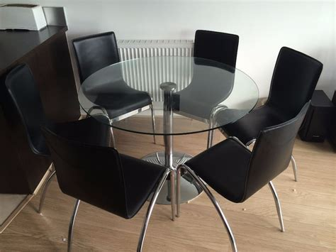black round dining table and chairs round glass dining table and 6 matching black leather and