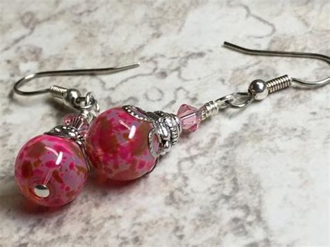 pretty  pink glass dangle earrings jills beaded knit bits
