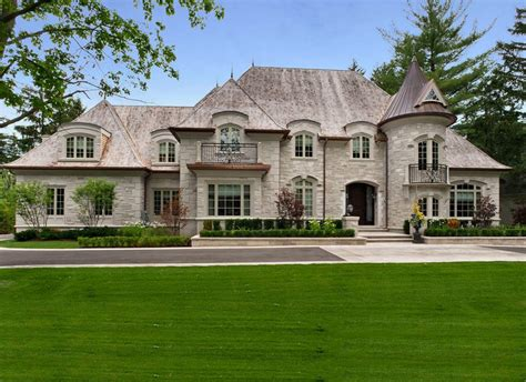 exterior facade traditional with stone wall decorative landscaping stones and pavers
