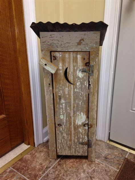 Small outhouse made from barn wood and distressed for my