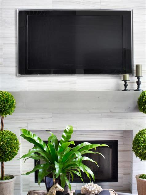 hanging a tv above fireplace installing a tv above the fireplace hgtv