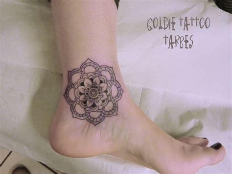 Écritures & Symboles  Goldie Tattoo