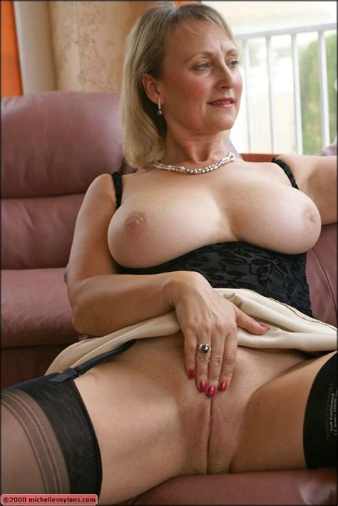 Mature Blonde With Huge Tits Posing Upskirt And
