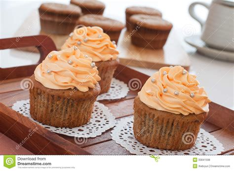 Homemade Cupcakes Served On Kitchen Table. Royalty Free