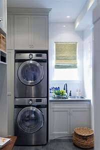 Stacked washer dryer transitional laundry room for Kitchen cabinet trends 2018 combined with oil rubbed bronze wall art