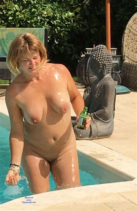 Sunbathing By The Pool   August         Voyeur Web