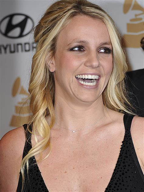 britney spears close  signing deal   factor