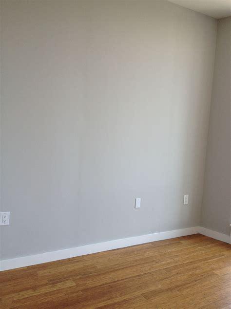 master bedroom gray walls  oak floors grey walls