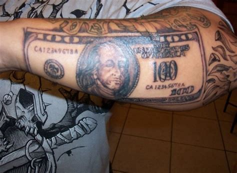 black  dollar tattoo  left forearm