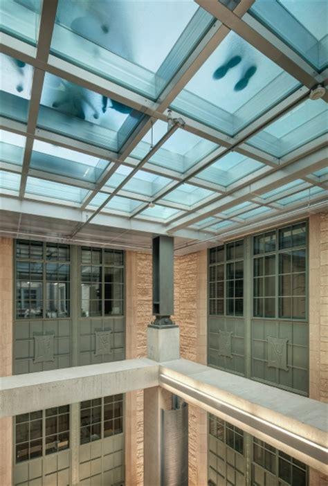 fire rated glass floor captures  light  northwestern