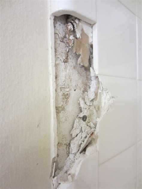 bathroom    remove  tile   wall