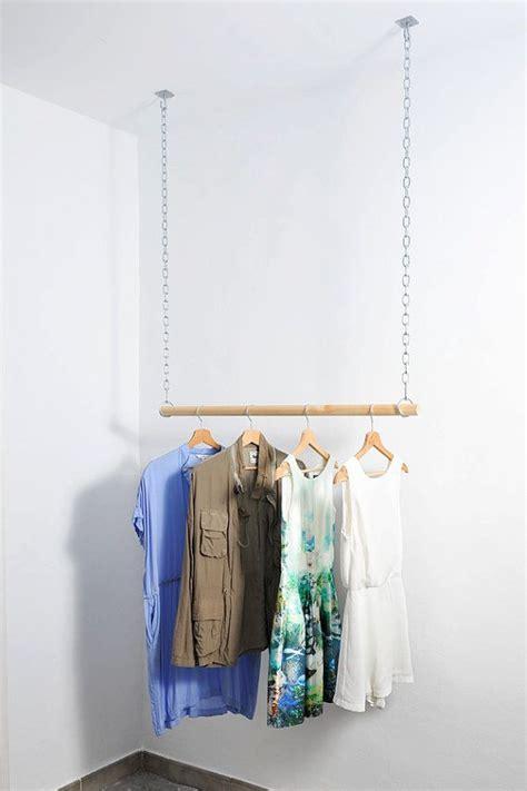 wooden floating hanging clothes rack van aveleredesign op