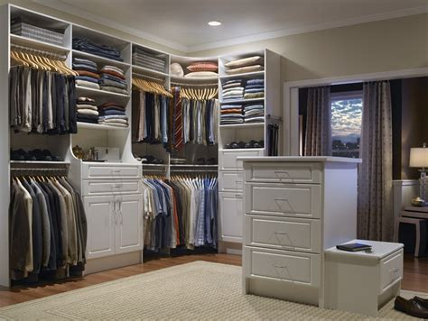 walk in closet with rods in corner in the closet