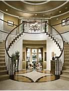 Luxury Foyer Decorating And Design Ideas 26 According To The Designer The Homeowners Wanted A More Of A Historical Wood Stairs And Wood Floor Give This Home S Foyer A Rich Design Tile Floor Designs Ideas On Pinterest Tile Floor Entryway Flooring