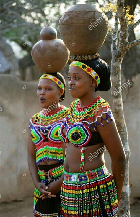 zulu girls wearing traditional beaded dress and ca