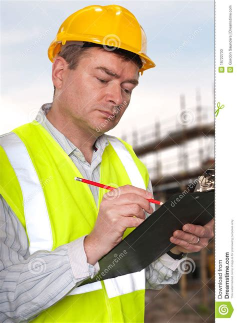 construction foreman checks clipboard stock photo image