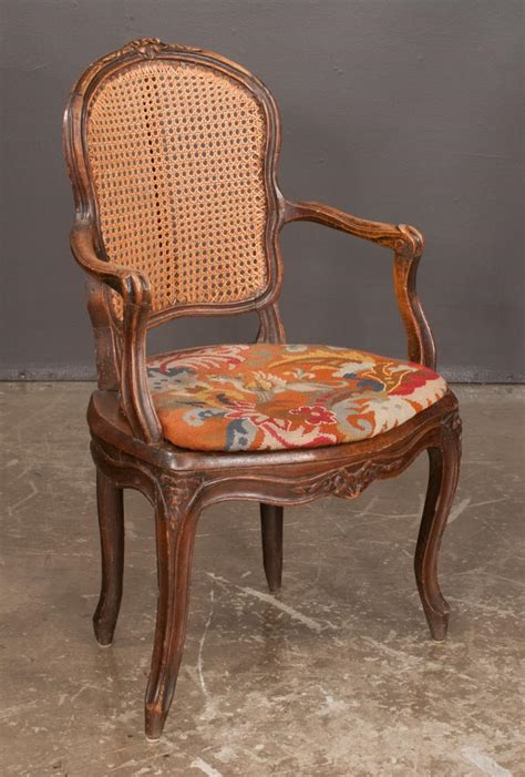 country louis xv design walnut fauteuil with floral c