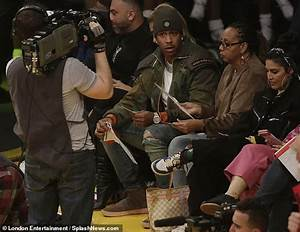 Rihanna is a die-hard sports fan as she puts on an ...