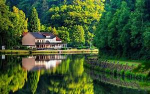 Natural house on lake wide screen HD image