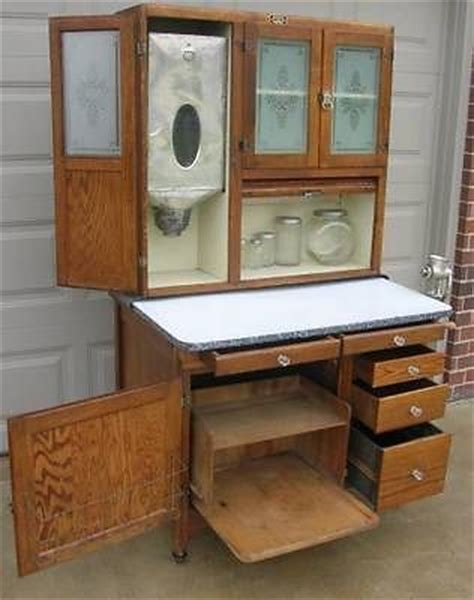 oak hoosier sellers cabinet w flour bin etched glass doors 8 pc glassware set antique