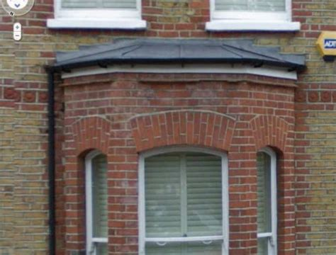 bay window hip roof lead roof roofing job  clapham