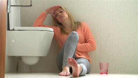 hung  teenage girl sits  floor  bathroom feeling