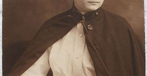Portrait Of An Early 20th Century Nurse In Full Uniform