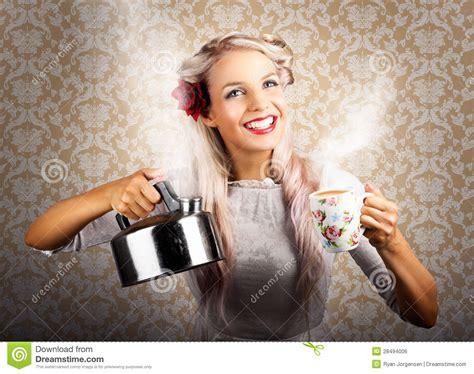 vintage coffee woman holding hot tea pot stock photo