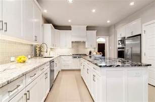 white kitchen glass backsplash white kitchen with gray glass backsplash and granite countertop contemporary kitchen