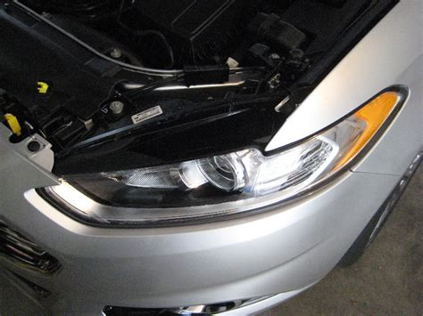 service manual how to change a headlight for a 2013 rolls