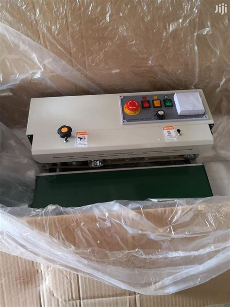 archive plantain chips packing machine continious bandsealer  uyo manufacturing equipment