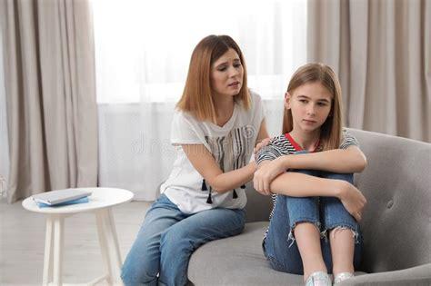 angry teenage girl   worried mother stock photo