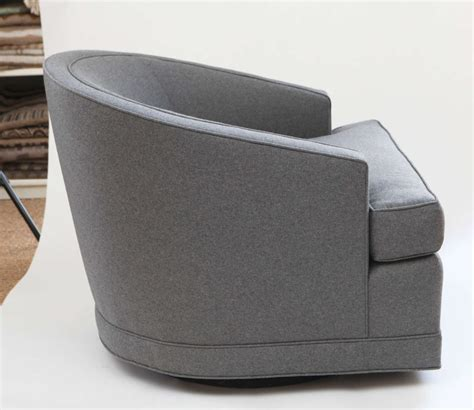 pair of grey flannel barrel back swivel chairs at 1stdibs
