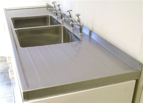 sink on top of counter sinks that sit on top of counter befon for