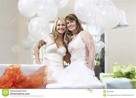 friends shower together and friend standing together at bridal shower