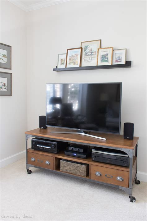 decor above tv how to decorate above the tv a simple solution driven