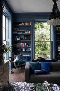 A dark, moody living room books in the home Pinterest