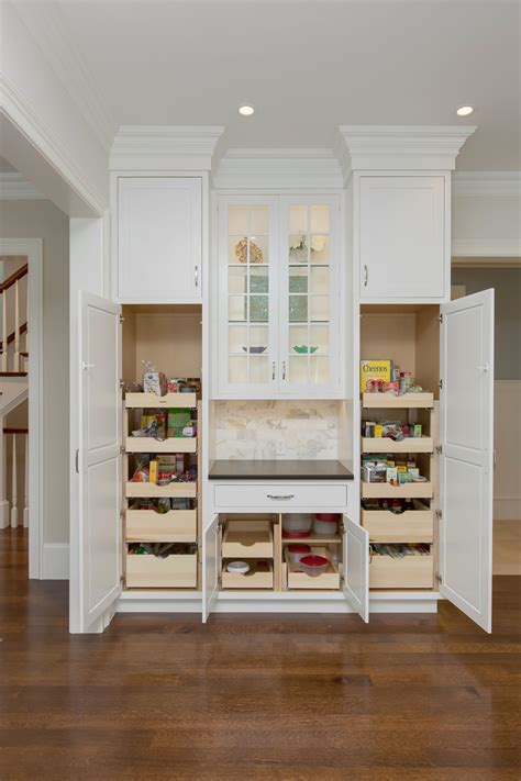 Kitchen Storage Cabinets by Pantry Cabinets With Pull Out Drawers And Crown Molding In
