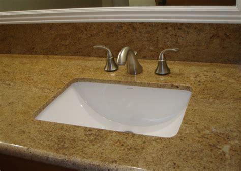 custom granite with undermount sink and kohler wide spread