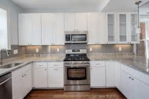 kitchen backsplashes for white cabinets white kitchen grey glass backsplash home design ideas