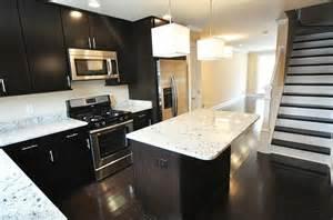 espresso kitchen cabinets with dark wood floors 3472