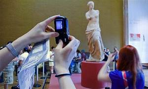 Want to remember an event? DON'T take photos of it: Study ...