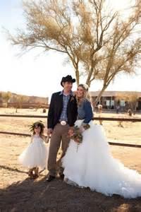 blue jean wedding denim jacket with wedding dress cowboy western country rustic barn wedding