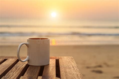 Coffee Cup On Wood Table At Sunset Or Sunrise Beach Stock Bunn Coffee Makers At Walmart Aeropress Type Drip Water Ratio Best Grinder Home Barista Inventor Pots Cheap Cold Brew