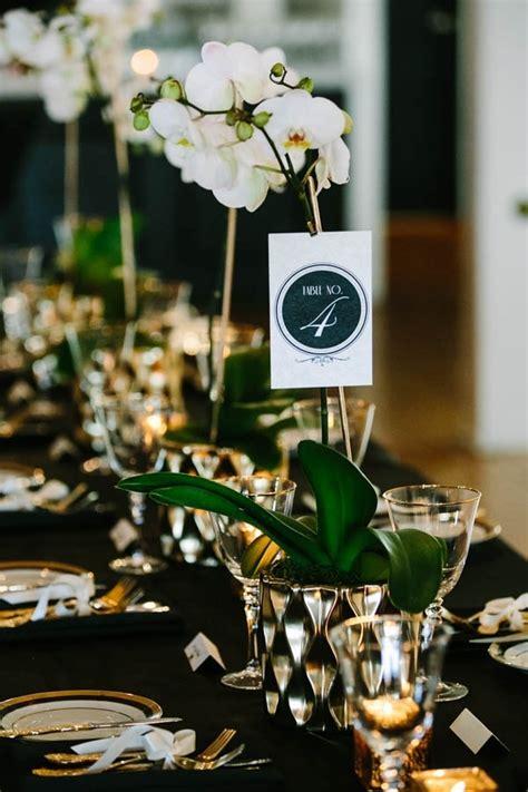 black white  gold tablescape  orchid centerpieces