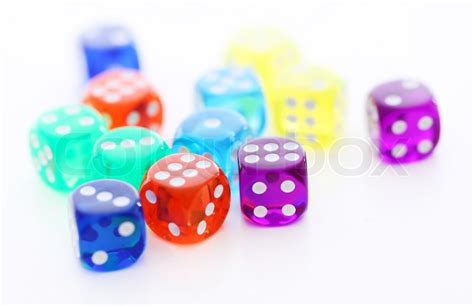 colored dice many colorful dice are lying together stock photo